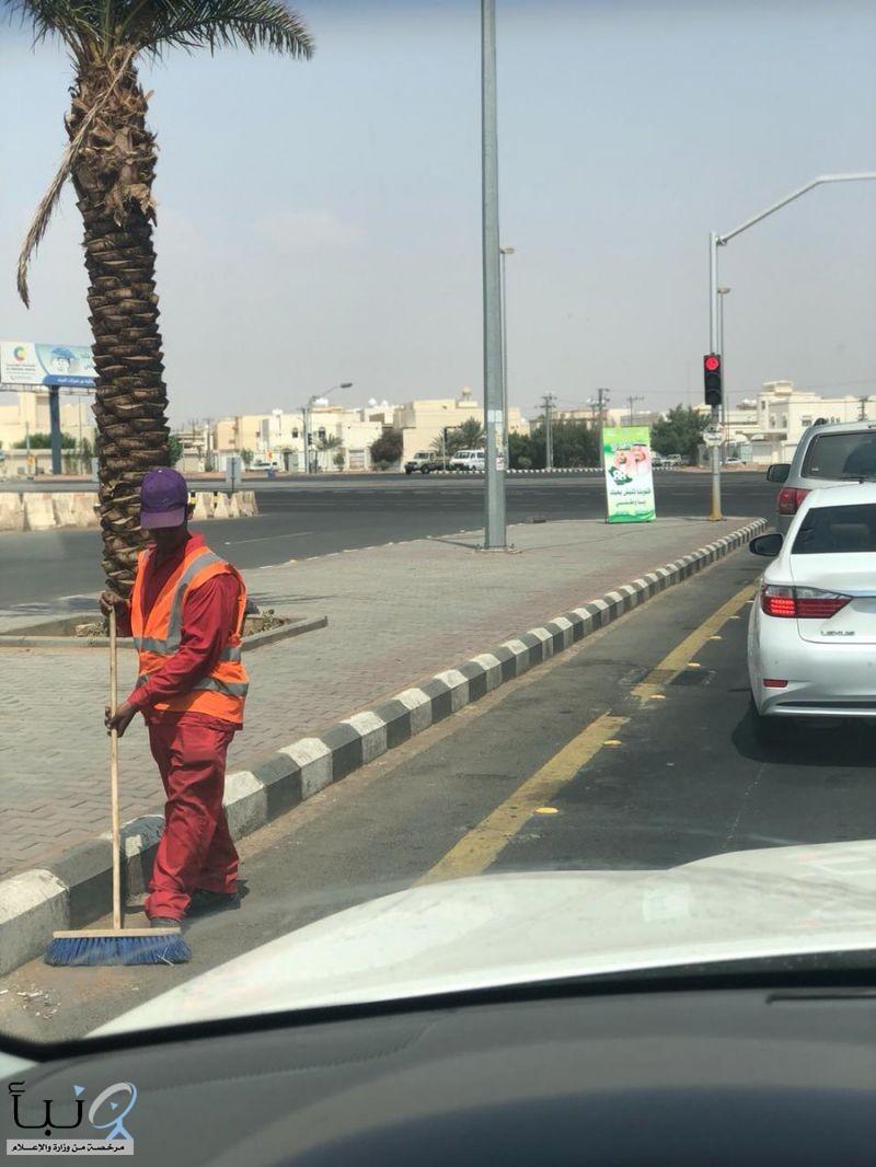 عمال النظافة و إشارات المرور